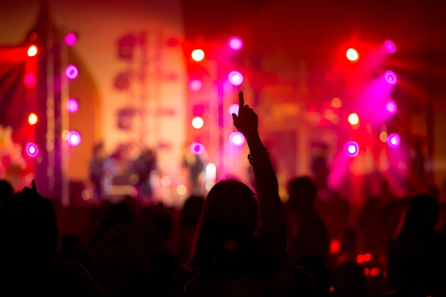 Funny girl hand up in concert Premium Photo