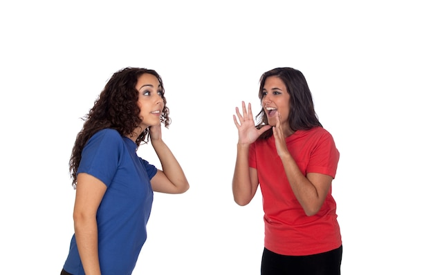 Funny girl shouting somethin to her friend isolated on white background Premium Photo