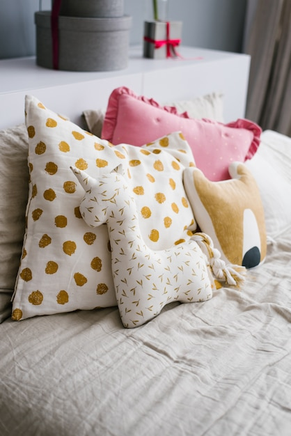 Premium Photo Funny Handmade Pillows Pillows In The Form Of Animals On The Bed In The Bedroom