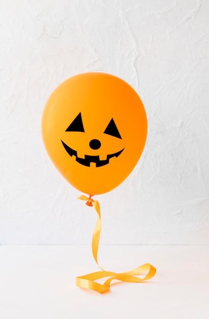 Funny jack-o-lantern balloon for halloween Free Photo