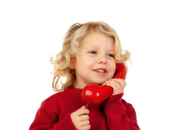 Funny little child talking on the phone Premium Photo
