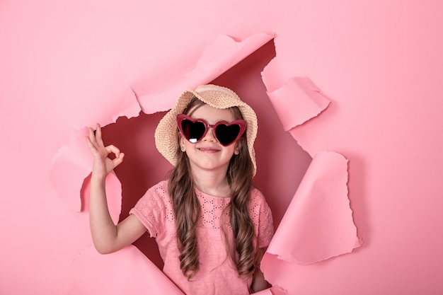 Funny little girl with glasses on colored Free Photo