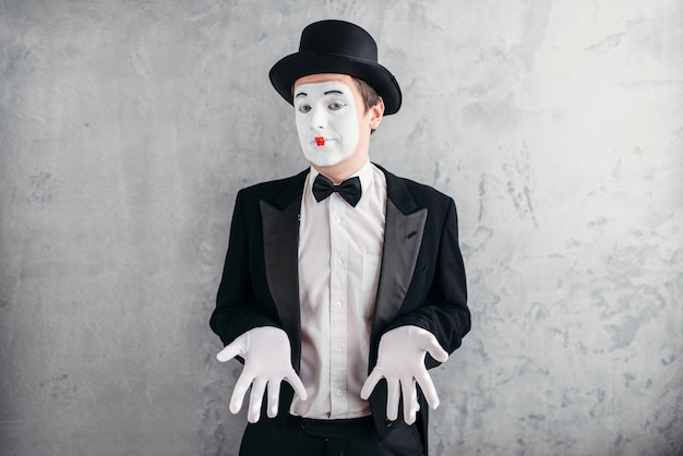 Funny male mime artist with makeup in gloves and hat. Premium Photo