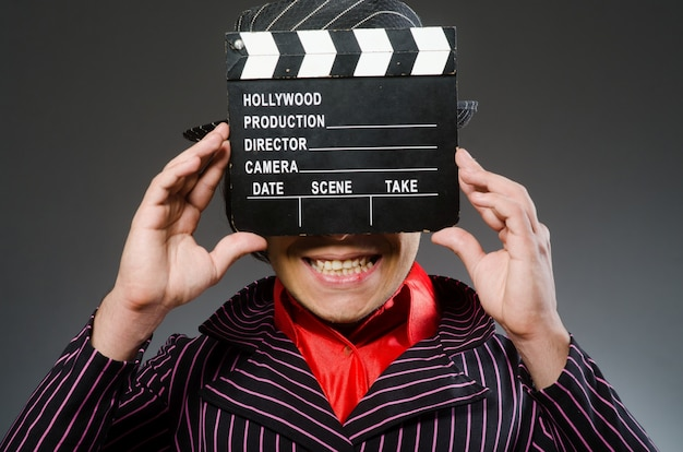 Funny man with movie board Premium Photo