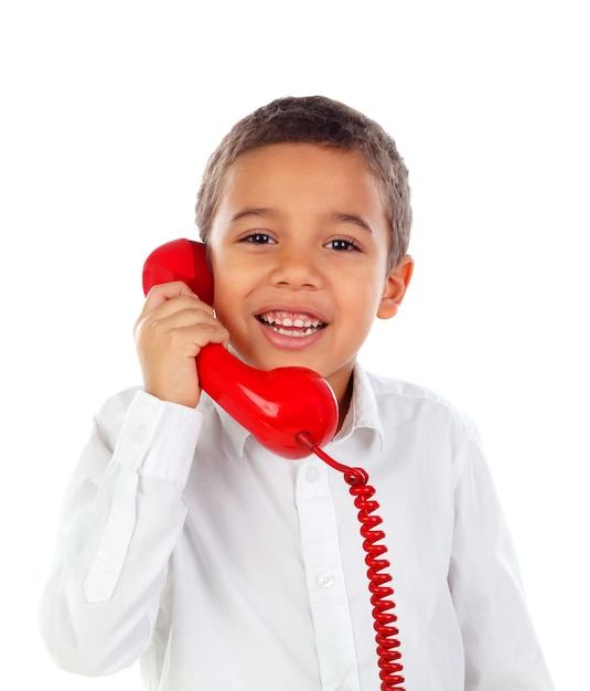 Funny small child talking on the phone Premium Photo