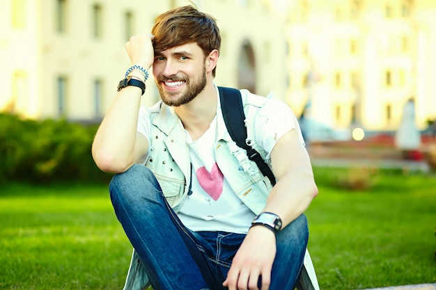 Funny smiling hipster handsome man guy in stylish summer cloth in the street in sunglasses Free Photo