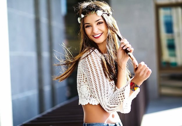 Funny stylish sexy smiling beautiful young hippy woman model in summer white fresh hipster clothes  in the street Free Photo