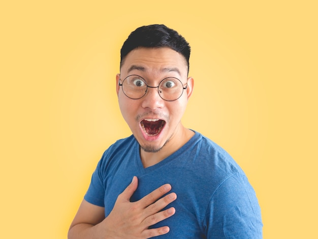 979c4314a0e Funny surprised and overjoyed face of asian man in blue t-shirt and  eyeglasses. Premium Photo