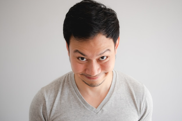 Funny tricky awkward smirk face of man in grey t-shirt ...