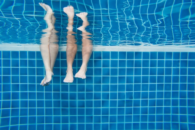 Funny underwater family legs in swimming poo 1253 1487