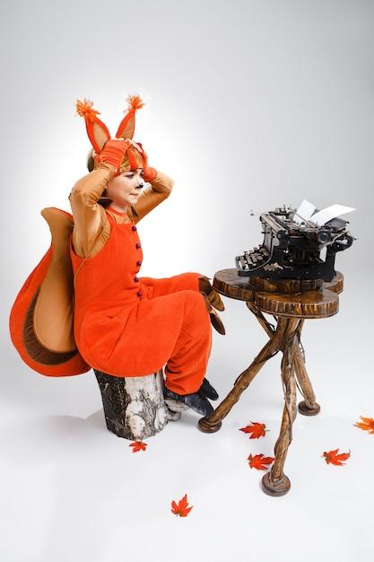 //image.freepik.com/free-photo/funny-woman-dressed-as-squirrel-typing-with-old-typewriter_155003-6089.jpg)