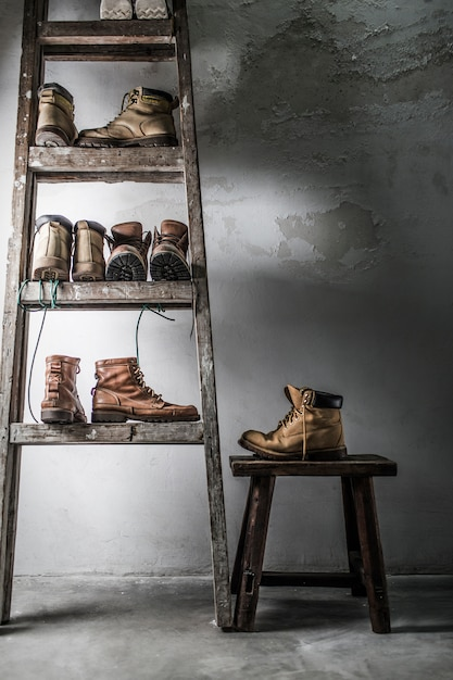 Furniture with different pairs of boots Free Photo