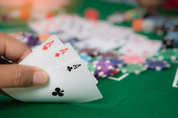 Gambling chips and cards on a green cloth casino table Premium Photo