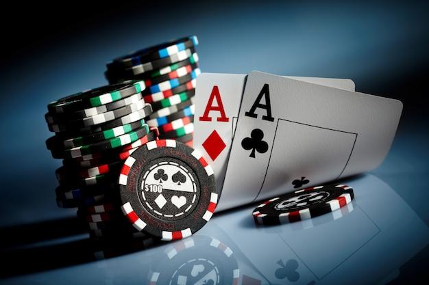 Gambling chips on the dark Premium Photo