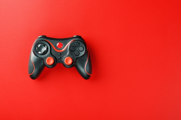 Game controller controller on red surface Premium Photo