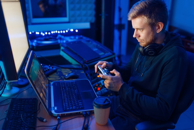 Gamer with joystick playing videogame on console Premium Photo