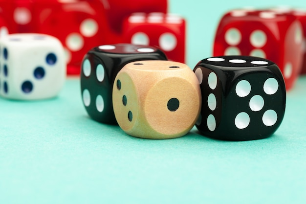 Gaming dices on blue background Premium Photo