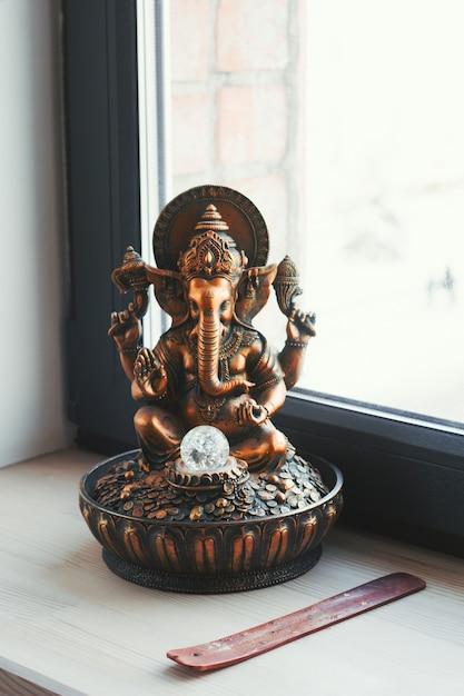 Ganesha statuette on a windowsill in yoga studio Premium Photo