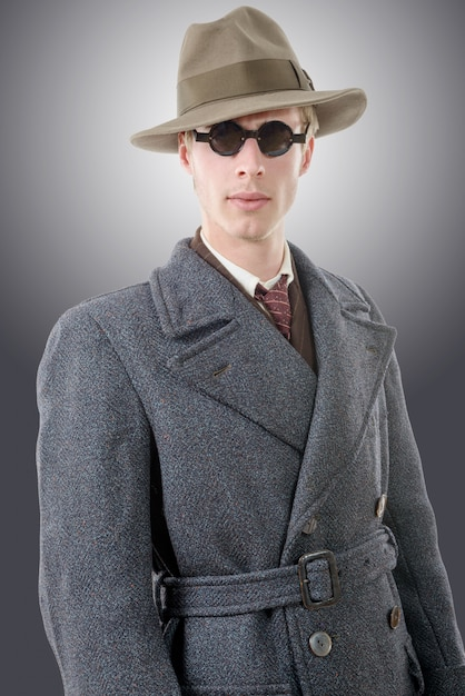 Gangster or fbi agent with a hat and black glasses Premium Photo