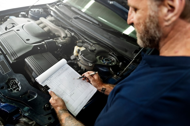 Garage motor maintenance mechanic fixing spare concept Premium Photo