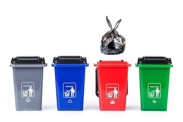 Garbage classification conceptŒcolorful plastic garbage cans isolated on white Premium Photo