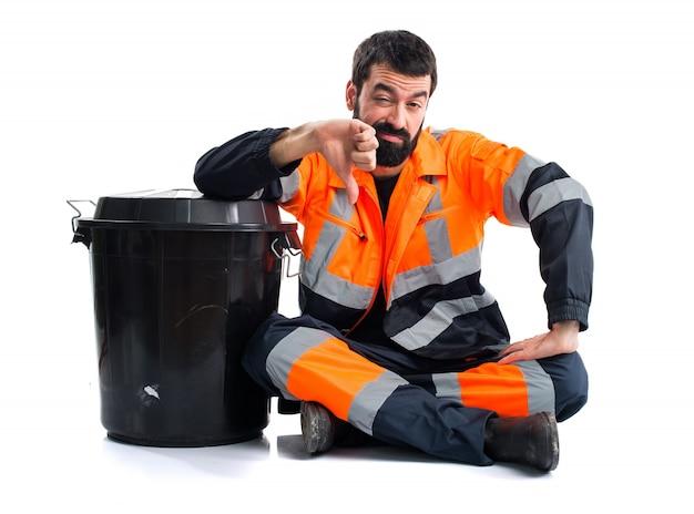 Garbage man doing bad signal Free Photo