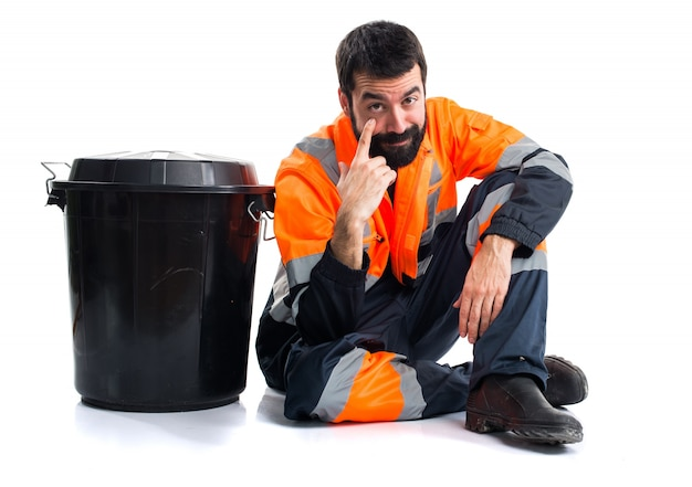 Garbage man showing something Free Photo