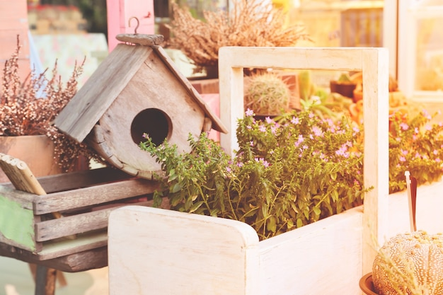 Garden decorations with bird house and small plants with spring season color Free Photo