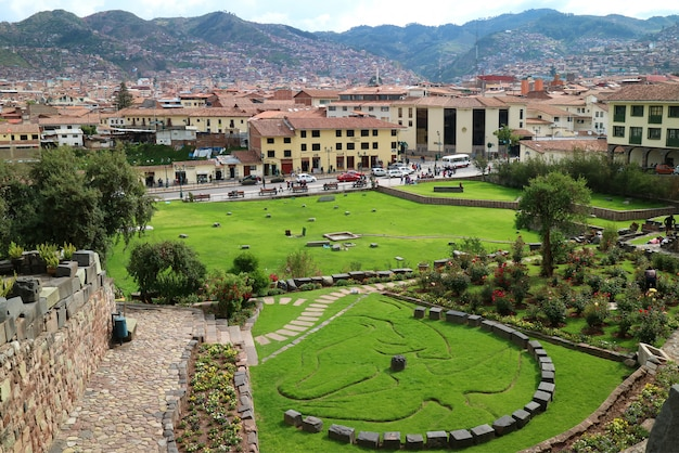 Garden outside coricancha temple in cusco of peru, with the symbol of inca mythology of condor Premium Photo