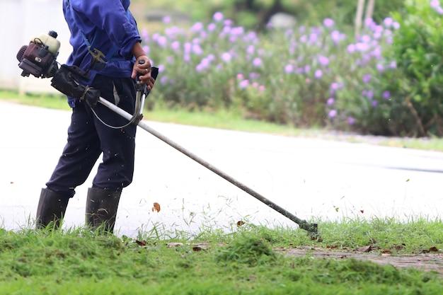 The gardener is cutting grass Premium Photo