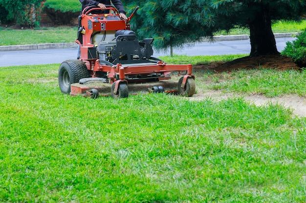 Gardening activity, lawn mower cutting the grass. Premium Photo