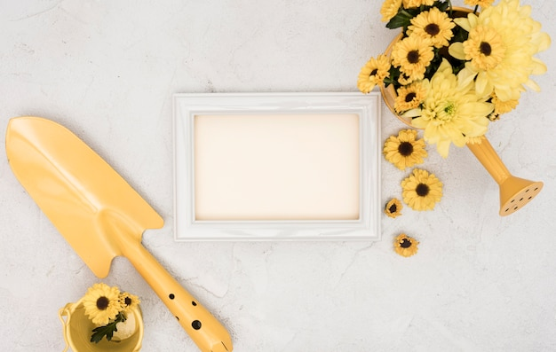 Gardening tools and flowers with empty frame Free Photo