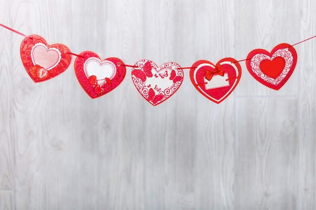 Garland of paper hearts. greeting stretching. Premium Photo