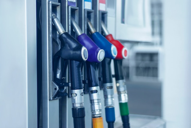 Gas station close-up with colored fuel hoses. Premium Photo