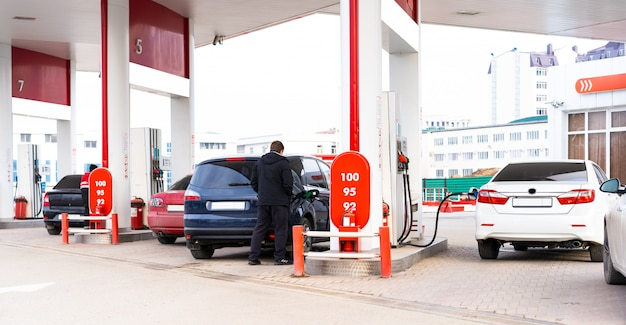 Gas station with cars refueling on it Premium Photo