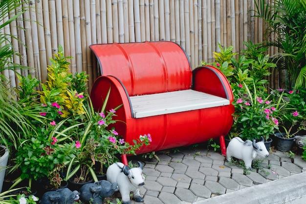 Gas tank chair orange-red on wood background. Premium Photo
