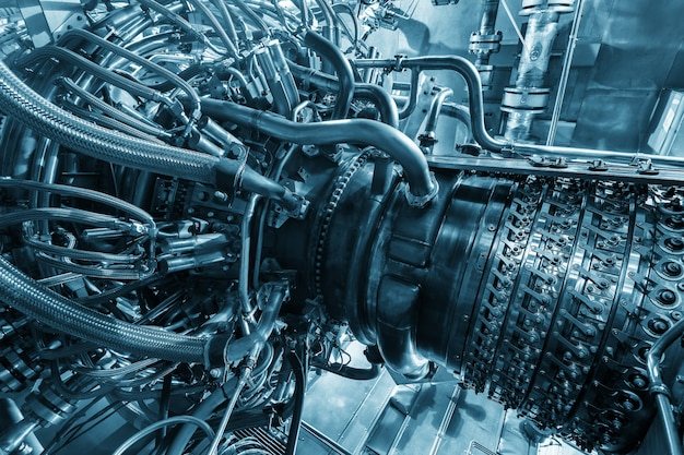 Gas turbine engine of feed gas compressor located inside pressurized enclosure, the gas turbine engine used in offshore oil and gas central processing platform. Premium Photo