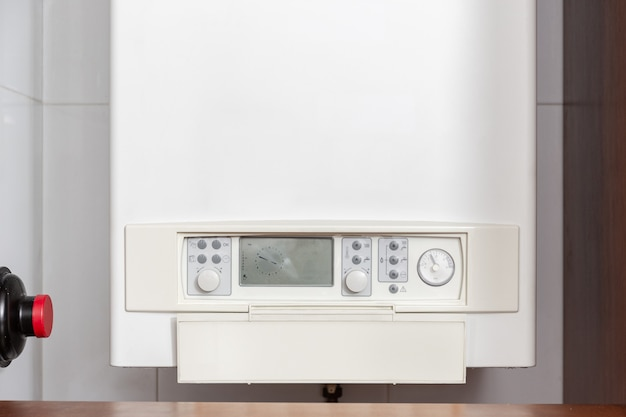 Gas water heater controlling panel or gas boiler in a home indoor Premium Photo