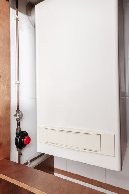 Gas water heater or gas boiler in a home indoor Premium Photo
