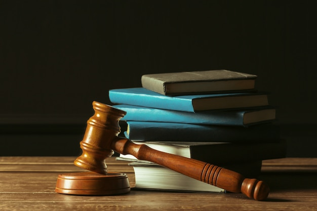 Gavel with books on old wooden desk Premium Photo