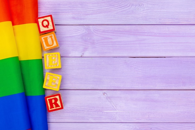 Gay pride flag on wooden table background Premium Photo