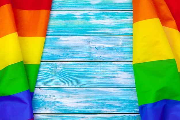 Gay pride flag on wooden table Premium Photo