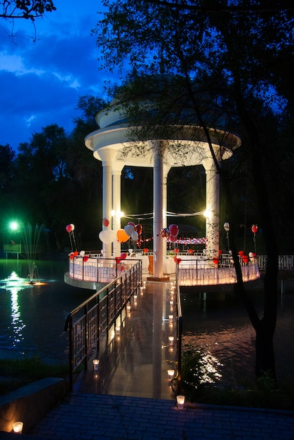 Gazebo in the middle of the lake at night Photo | Premium