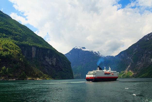 Geiranger fjord, ferry, mountains, beautiful nature norway panorama Premium Photo