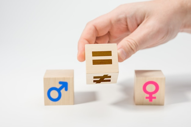 Gender equality concept on wooden cubes. concepts of gender equality Premium Photo