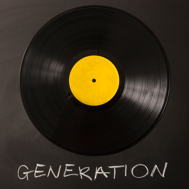 Generation text with black vinyl record on background Premium Photo