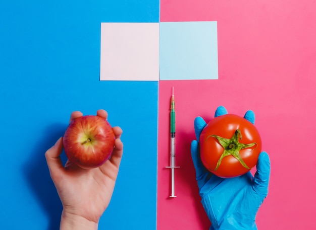 Genetically modified food concept on pink and blue background Premium Photo