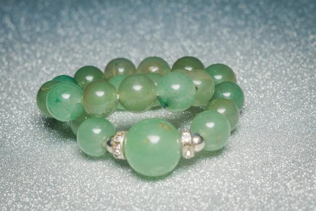 Genuine green beaded bracelet Premium Photo