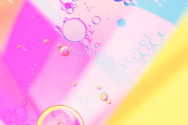 Geometric colourful background and bubbles Free Photo