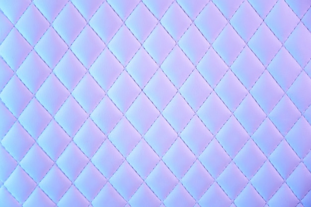 Geometric diamond pattern quilted pu leather in neon light Premium Photo